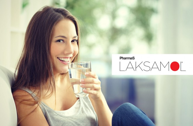 Girl drinking water at home